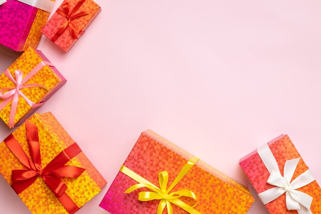 Top view of gift boxes frame for celebration christmas birthday or new year on pink