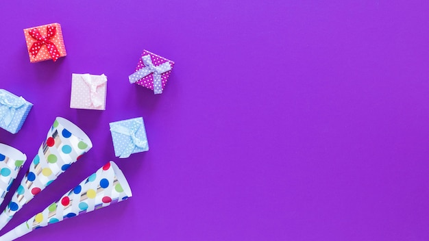 Top view gift boxes on purple background