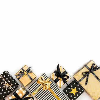 Top view of gift boxes in various black, white and golden