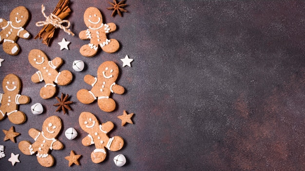 Top view of gingerbread cookies with cinnamon sticks for christmas and copy space