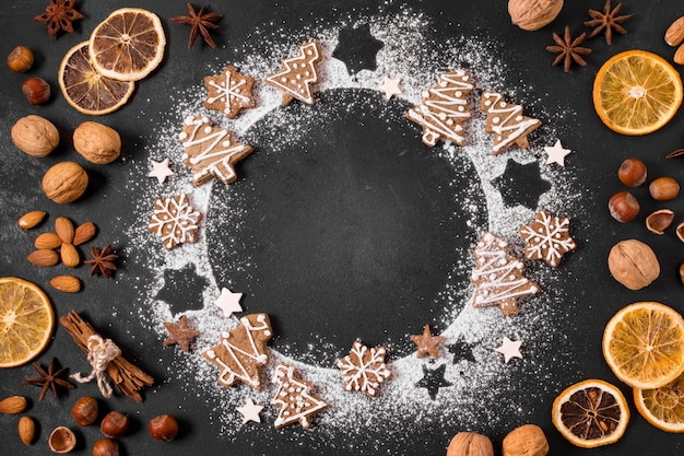 Top view of gingerbread cookies wreath with dried citrus and nuts
