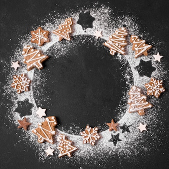 Top view of gingerbread wreath with flour
