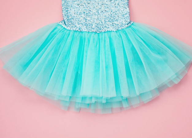 Top view over the girl ballet tutu dress over the pink.