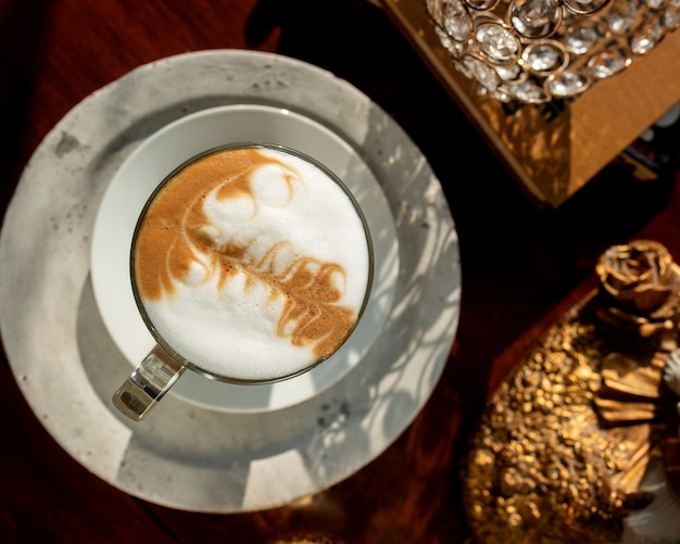 Top view of a glass of coffee with latte art