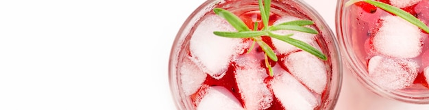 Top view glass of cranberry vodka with ice and copy-space