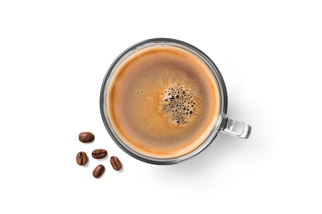 Top view of glass cup of espresso coffee and coffee beans isolated on white