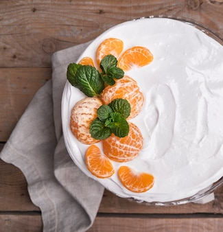 Top view glazed cake with oranges