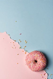 Top view of glazed doughnut with sprinkles and copy space