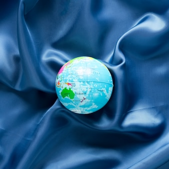 Top view of globe on blue satin