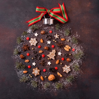 Top view of globe shape for christmas with gingerbread cookies and red berries