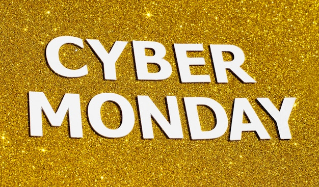 Top view of gold glitter for cyber monday