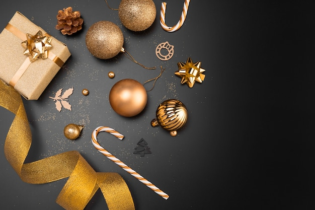 Top view of golden christmas ornaments with copy space