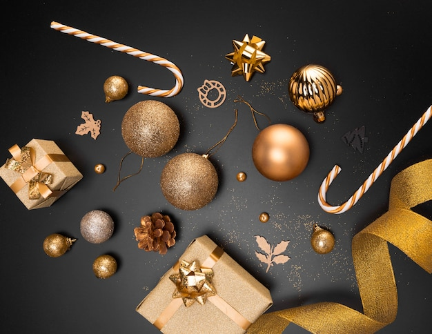 Top view of golden christmas ornaments with present