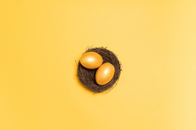 Top view of golden eggs in the nest