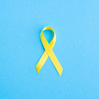 Top view golden ribbon awareness concept