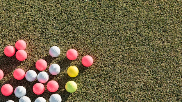 Top view golf balls collection with copy-space