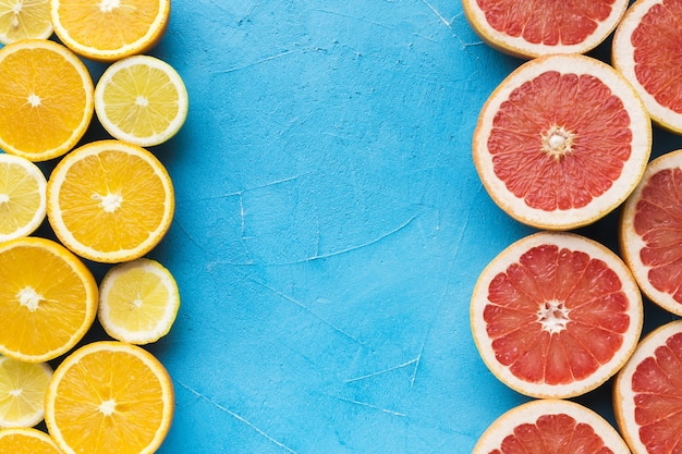 Top view of grapefruit and lemon with copy space