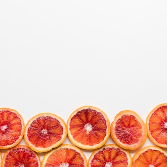 Top view grapefruit slices with copy space