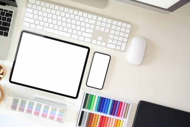 Top view graphic designer workspace with creative supplies