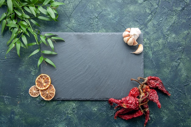 Top view gray platten with dried pepper on dark blue background color photo cook blue sea food kitchen desk