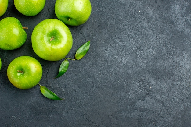 Top view green apples on dark surface free space