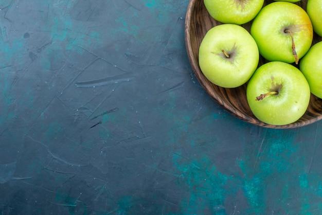 Top view green apples fresh mellow fruits on the dark blue desk