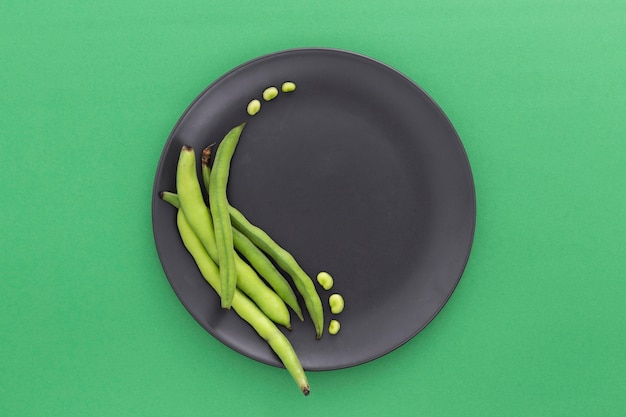 Top view green beans on plate