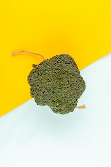 Top view green broccoli fresh ripe on the colorful background