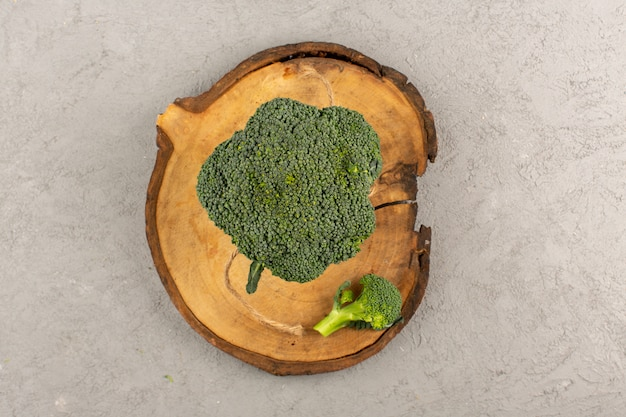 Top view green broccoli fresh ripe on the grey background