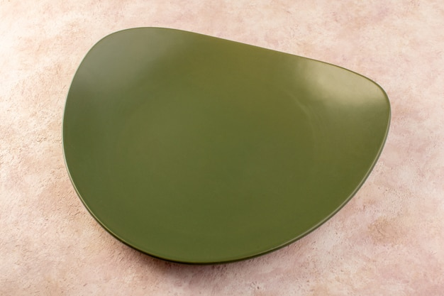 A top view green designed plate empty glasss made meal table
