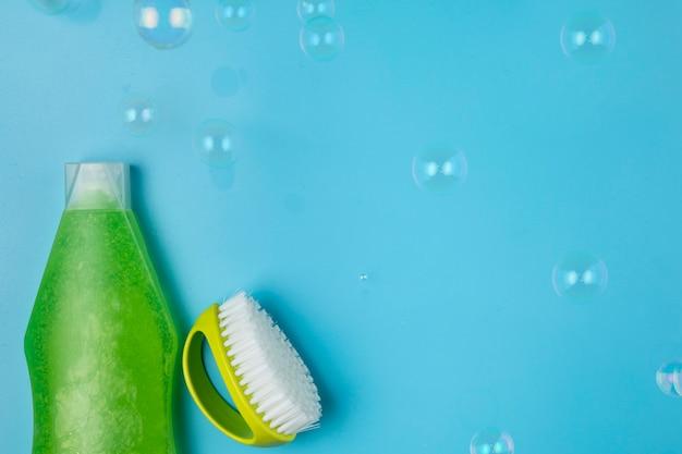 Top view green detergent and brush arrangement