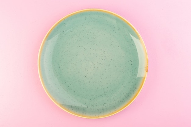 A top view green empty plate glass made for meal on pink