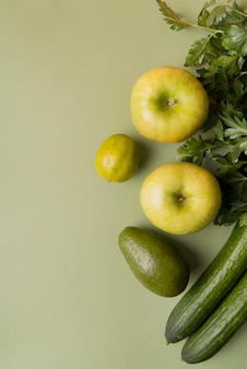 Top view green fruits and vegetables with copy-space