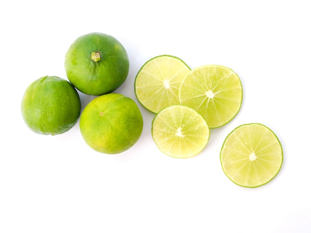 Top view of green lemon, juice slice of lime isolated