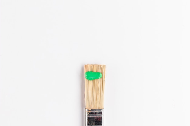 Top view of green paint on brush