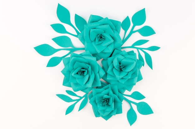 Top view green paper flowers on white background