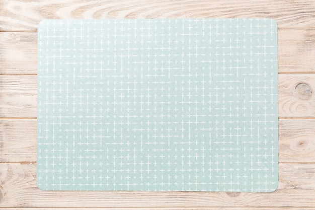 Top view of green place mat for a dish