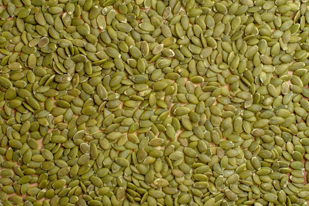 Top view of green pumpkin seeds seed nut many green