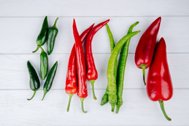 Top view of green and red hot chili peppers isolated on white