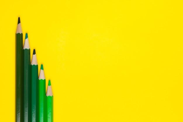Top view green sharp wooden pencils