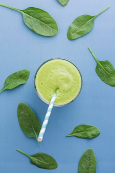 Top view green smoothie with leaves