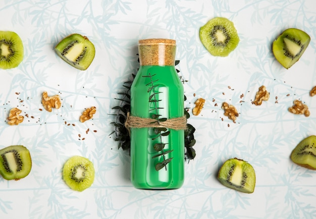 Top view green smoothie with nuts seeds and kiwi