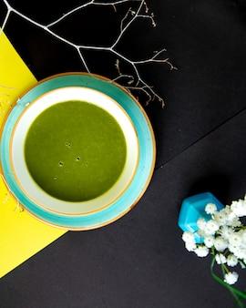 Top view of green vegetable soup