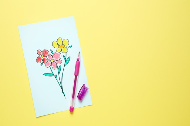 Top view of greeting card with drawn flowers on yellow background. happy mother's day