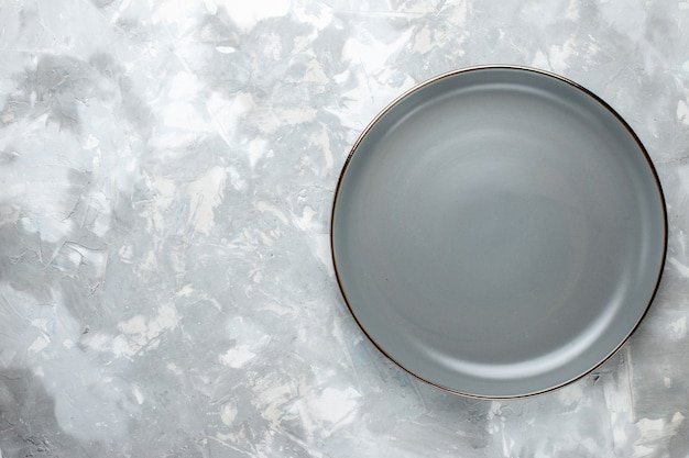 Top view of greyed plate empty on grey desk,  kitchen plate food