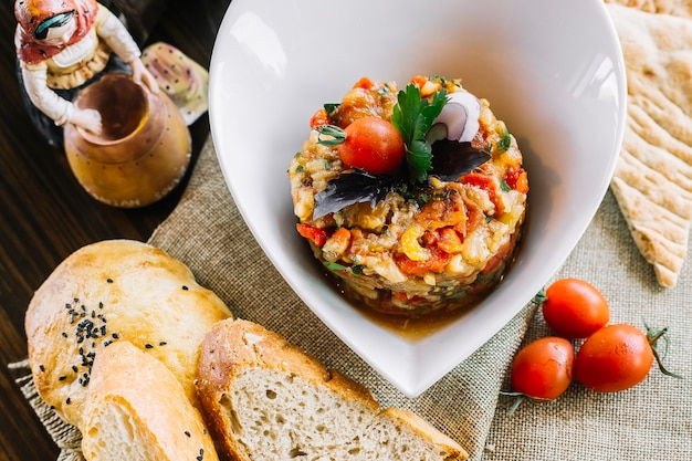 Top view grill vegetable salad with tomatoes and bread