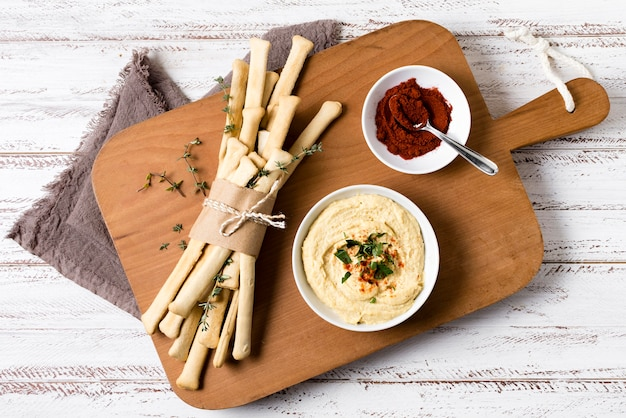 Top view of grissini with hummus