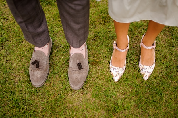 Top view of groom and bride legs