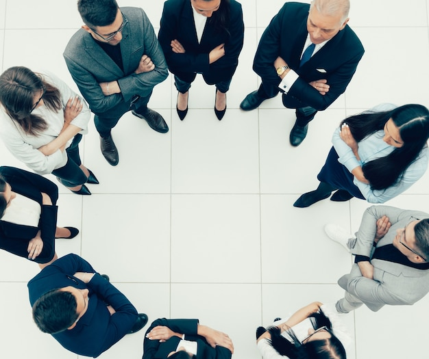 Top view. group of business people standing in a circle. the concept of team building