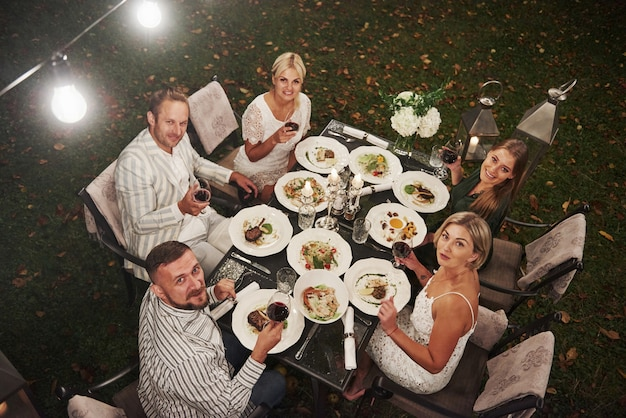 Top view of group of friends in the elegant wear have luxury dinner